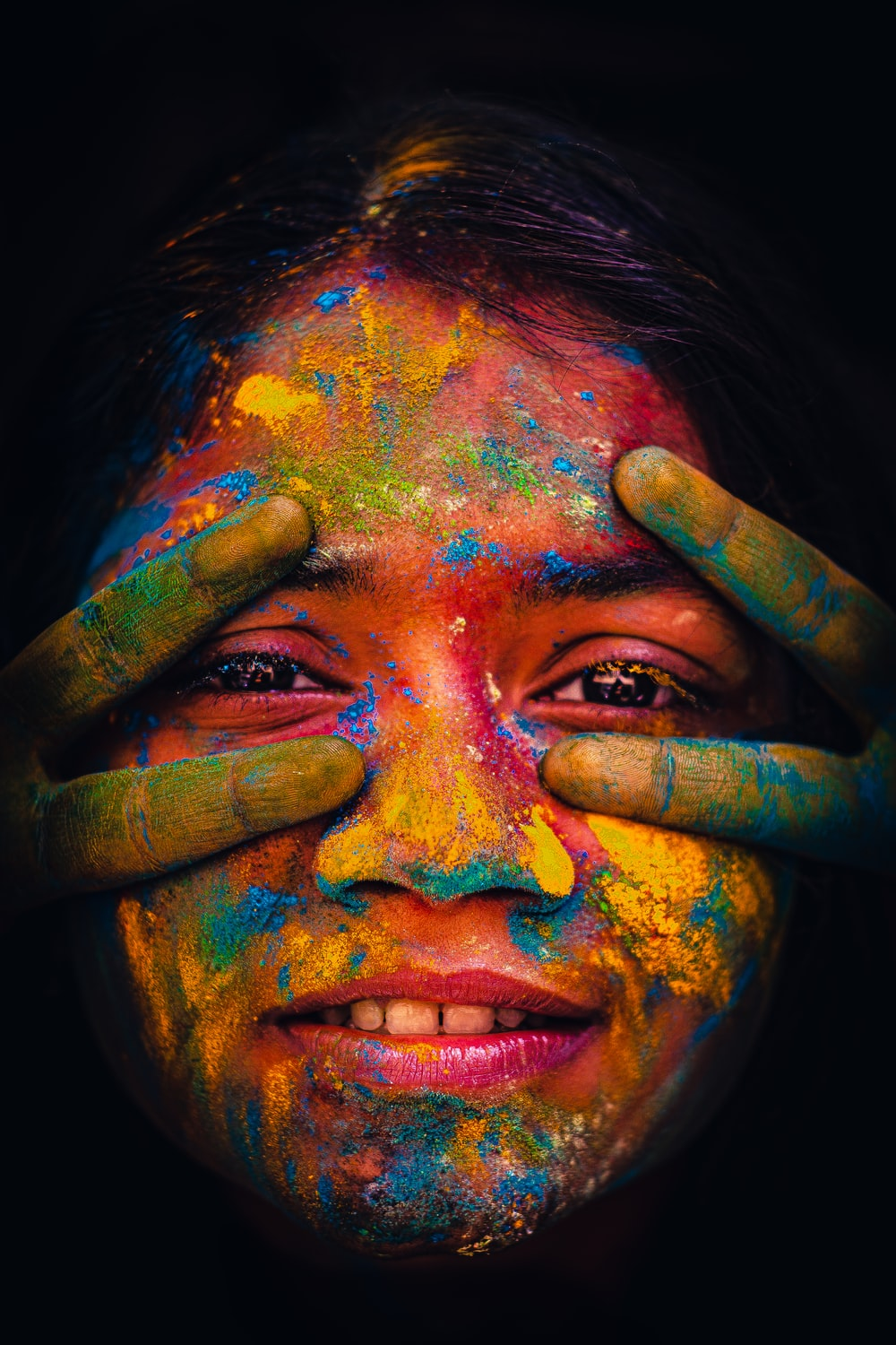 woman with blue and green paint on face