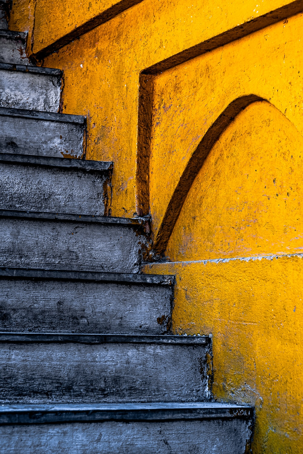 blue and yellow concrete staircase