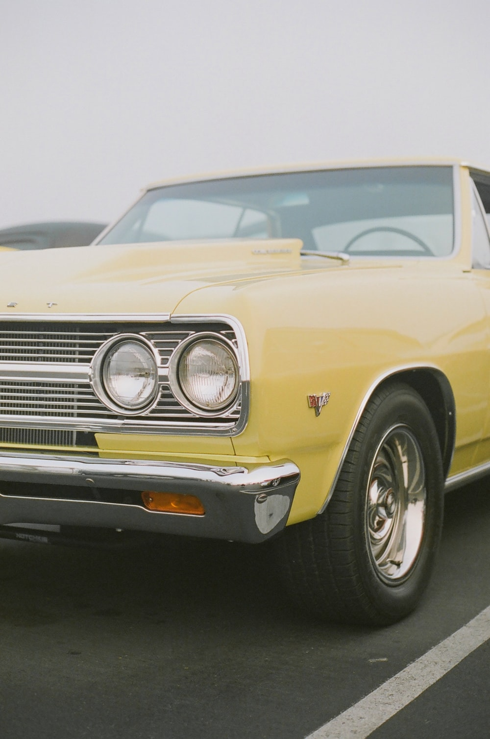 yellow classic car in close up photography