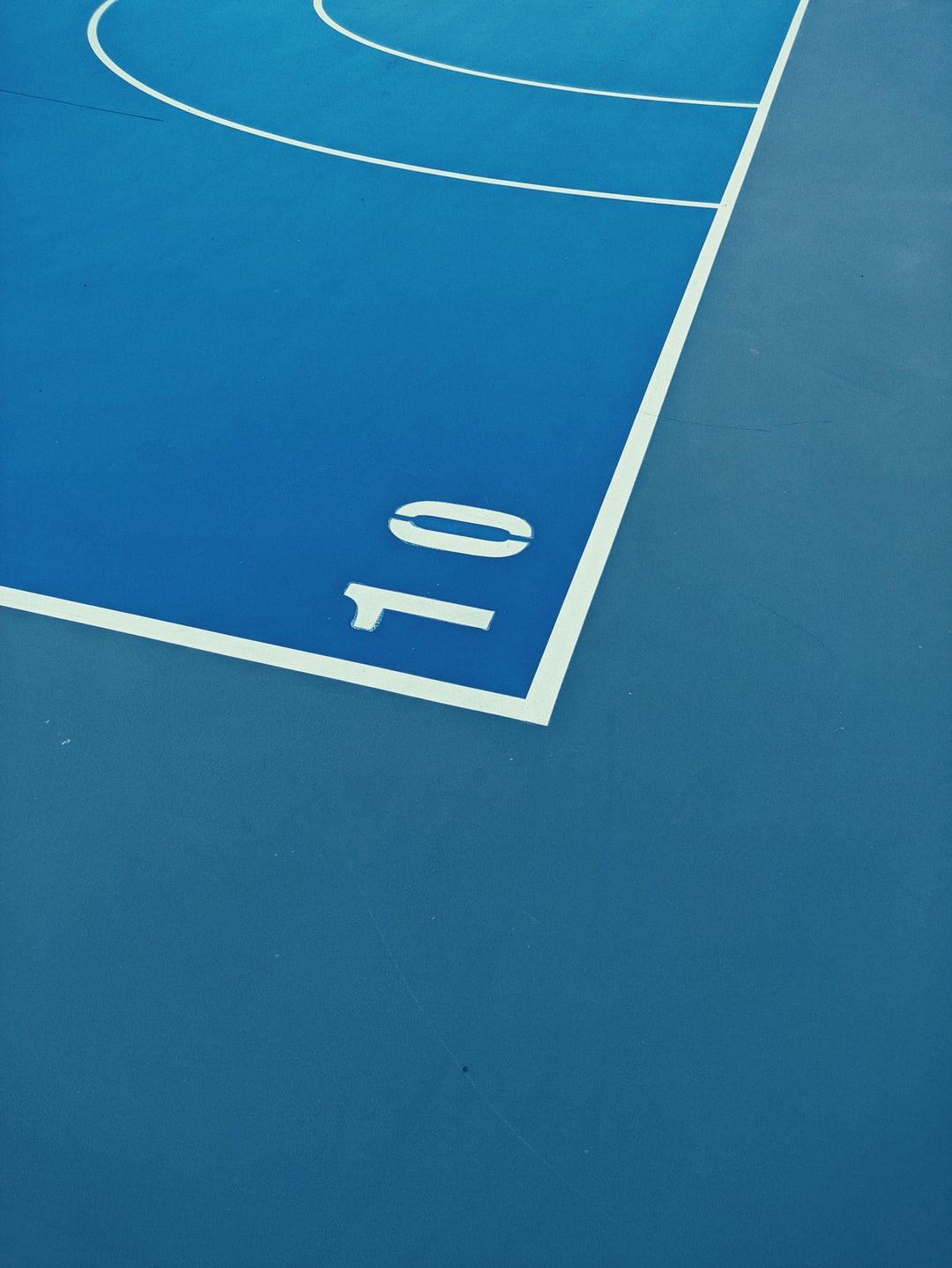Lines and colours of a blue netball court