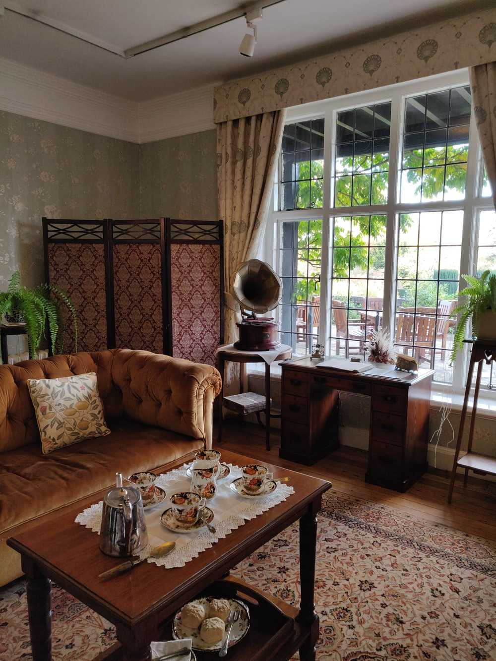 brown wooden table with white and brown floral table cloth