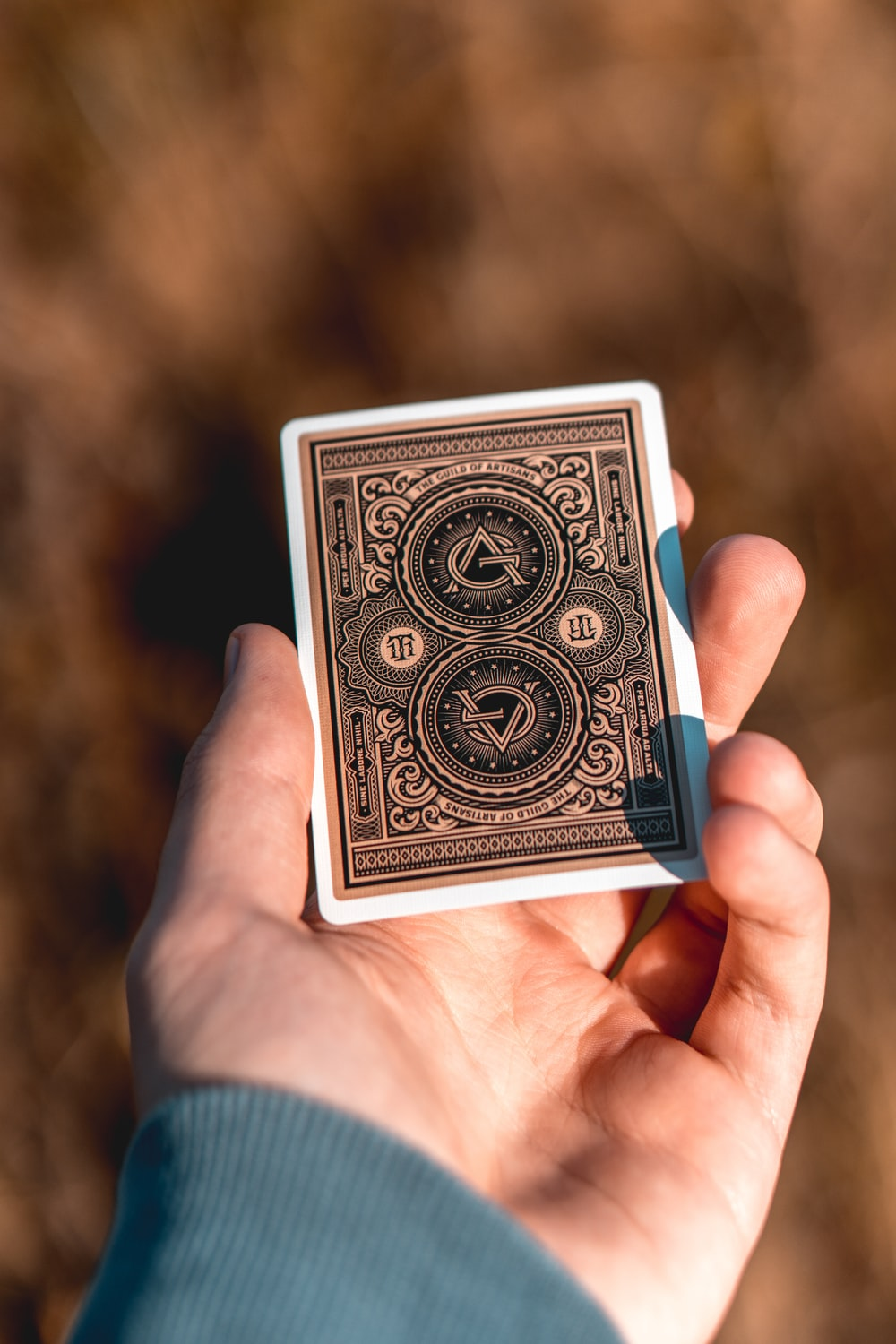 person holding black and white playing card