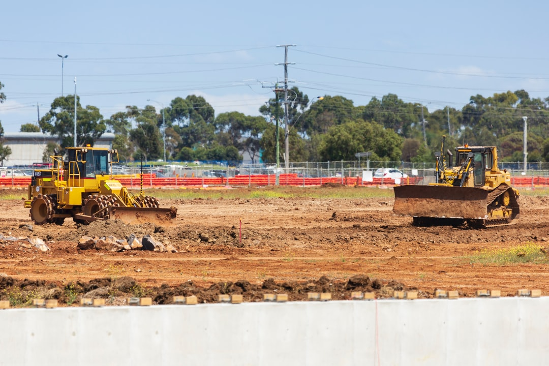 Dozers at work on construction site.