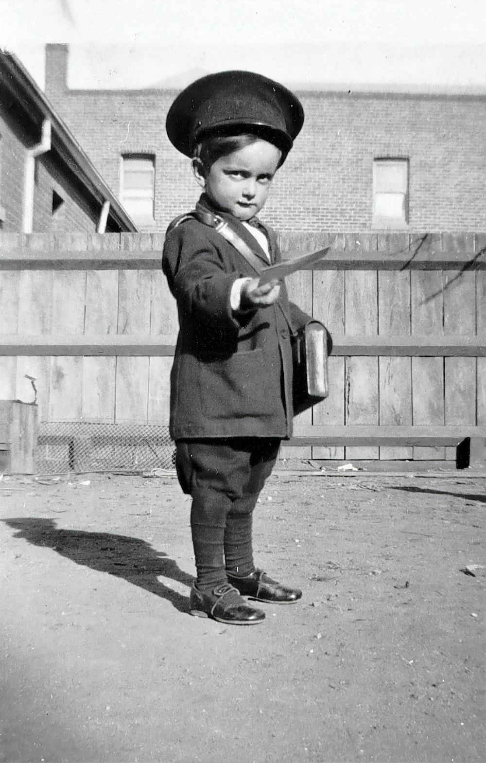 boy in black long sleeve shirt holding a stick