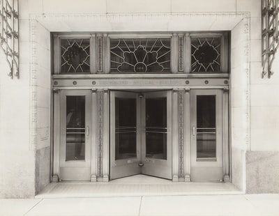white wooden framed glass window art deco teams background