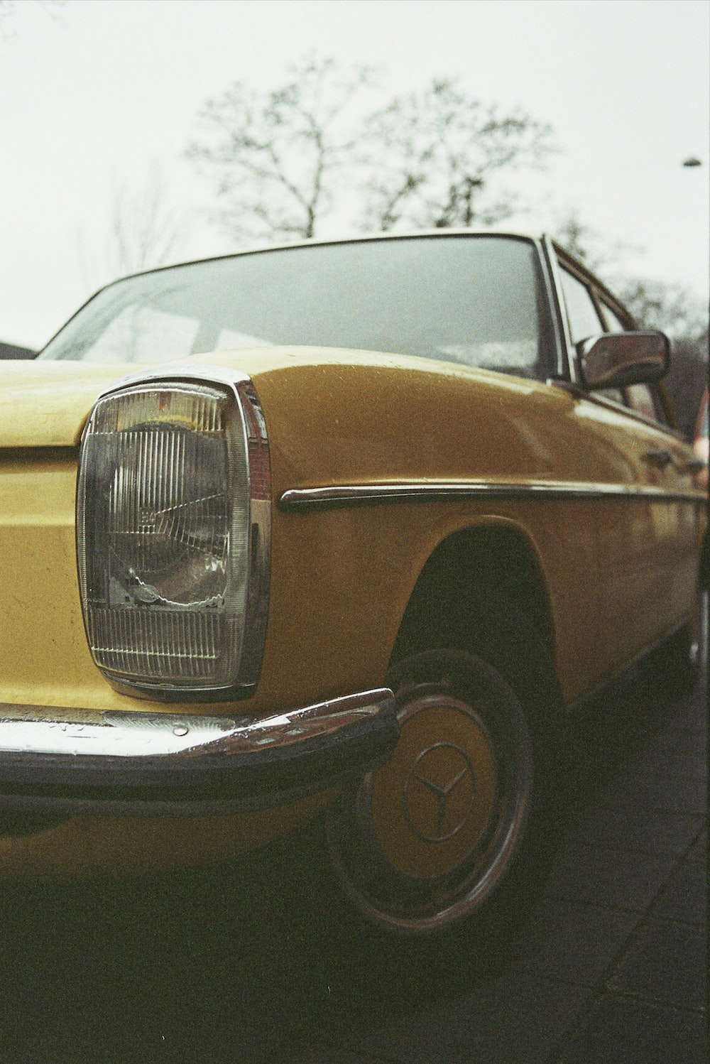 yellow and black car on gray pavement