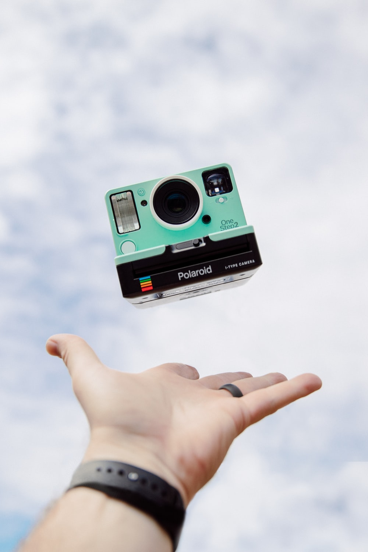 green and black polaroid camera