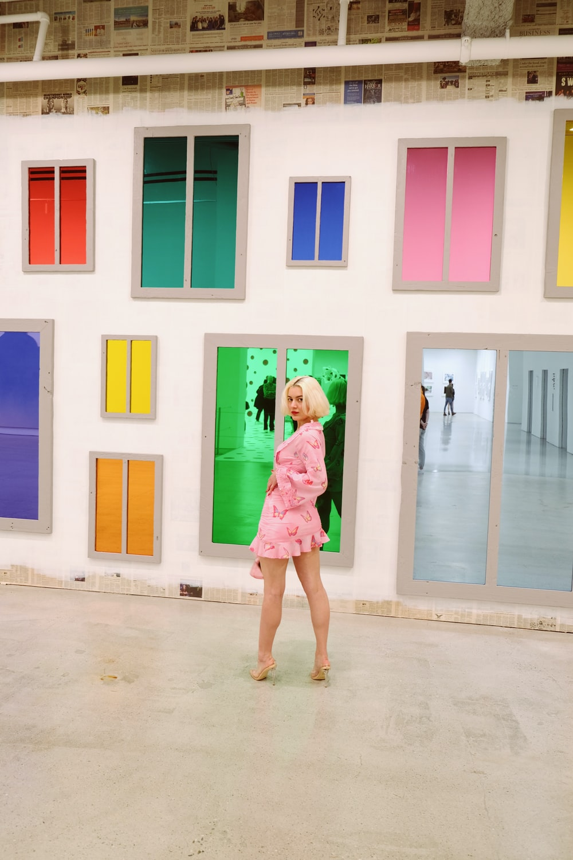 girl in pink dress standing on white floor