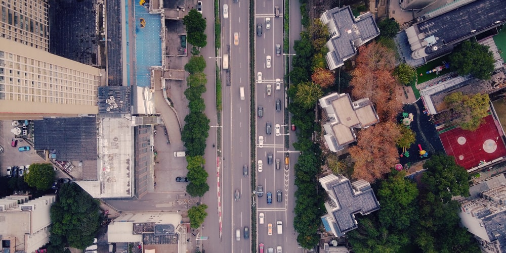 aerial view of cars on road near buildings during daytime