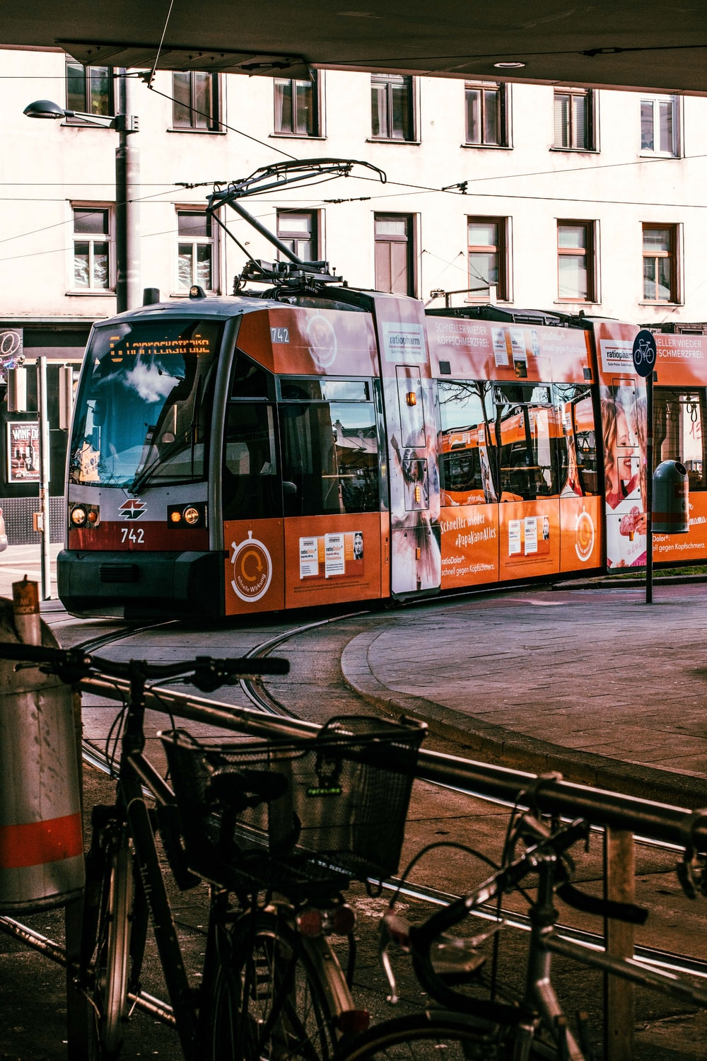 orange and white tram on road during daytime