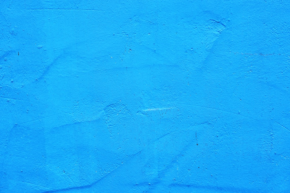 blue painted concrete wall during daytime