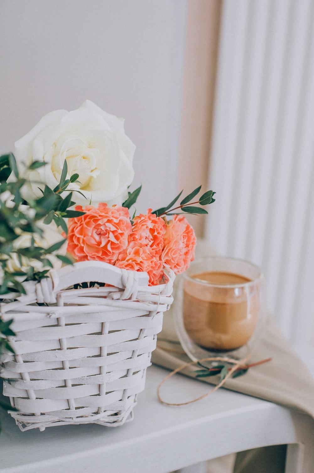 white rose in white wicker basket