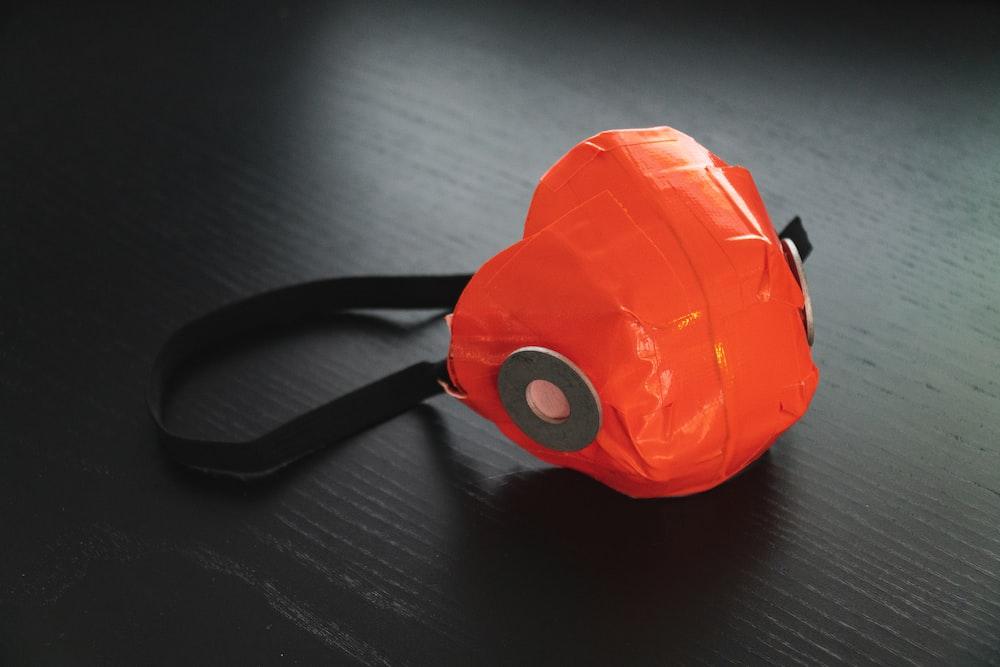 orange and black plastic toy