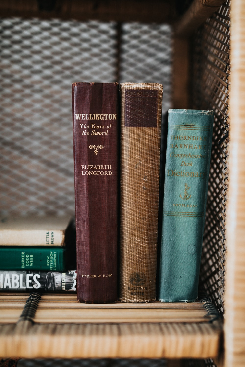 book collection on brown wooden shelf