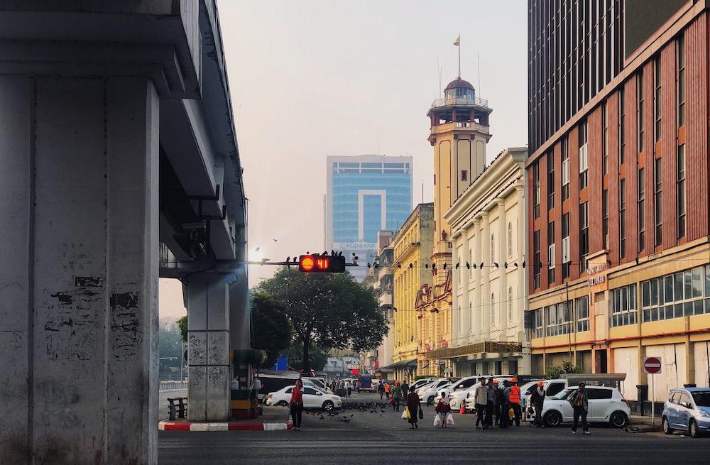 people walking on street near beige concrete building during daytime
