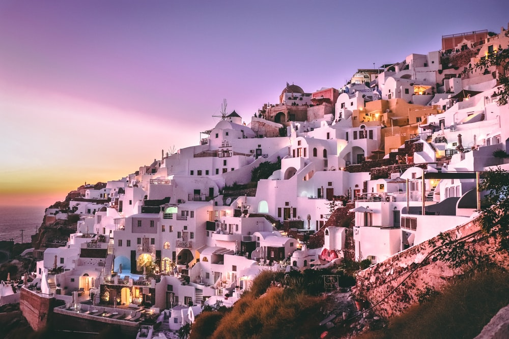 white concrete houses on hill during daytime