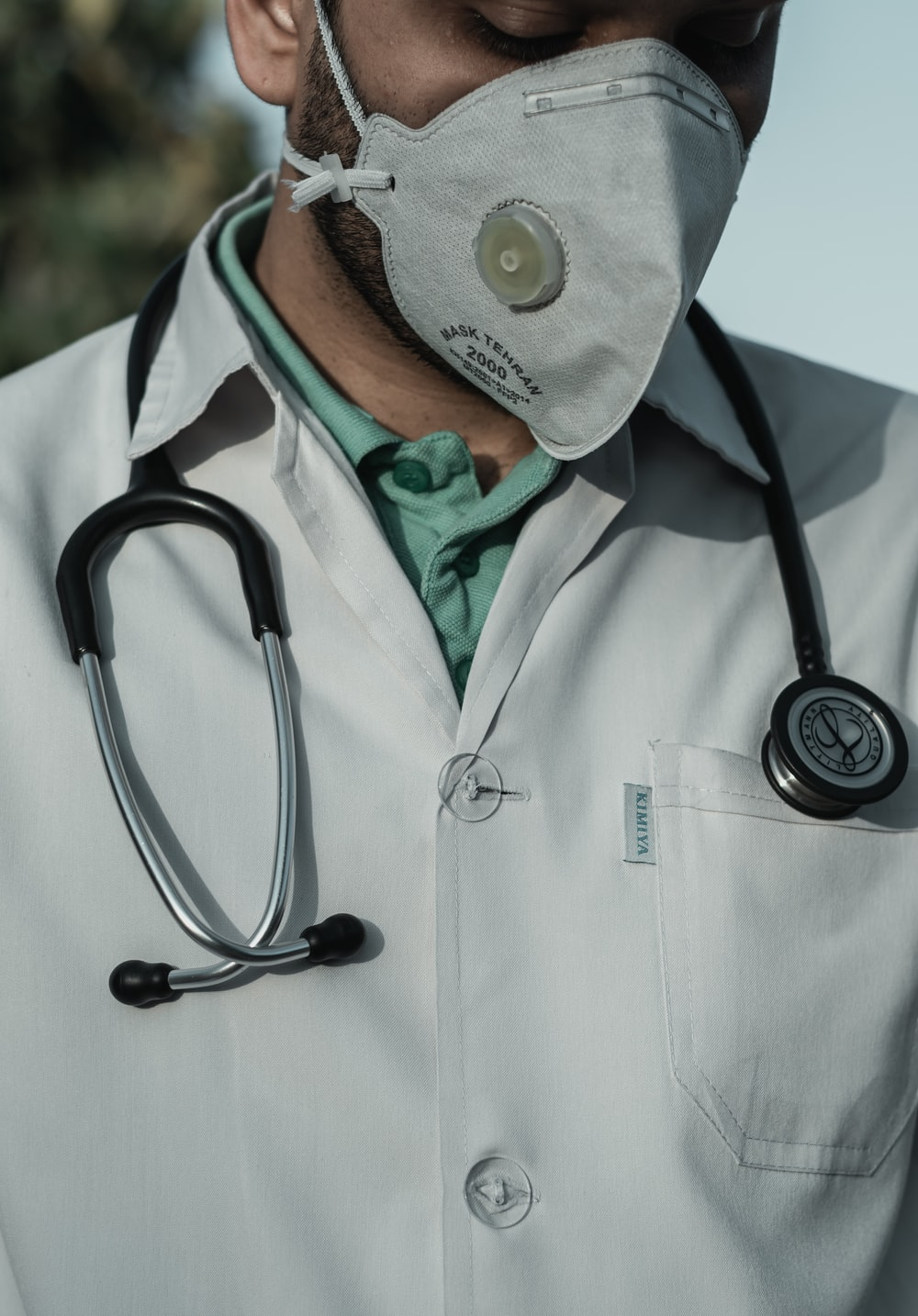 person in white and black stethoscope