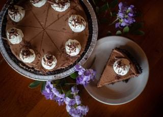 white and brown round cake on white ceramic plate