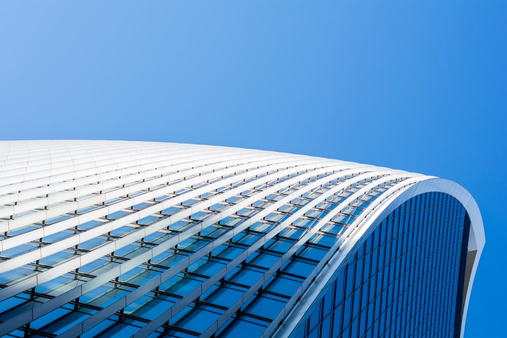 white and blue glass building