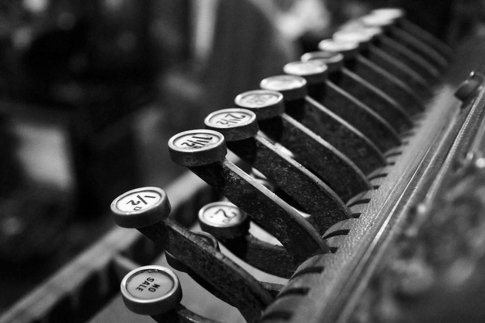 grayscale photo of typewriter keys