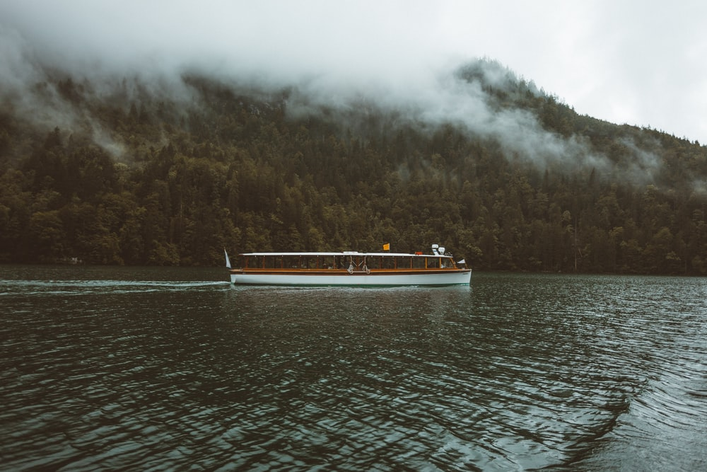 white boat on body of water during daytime