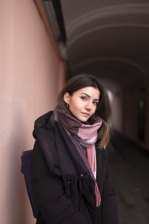 woman in black coat wearing brown scarf