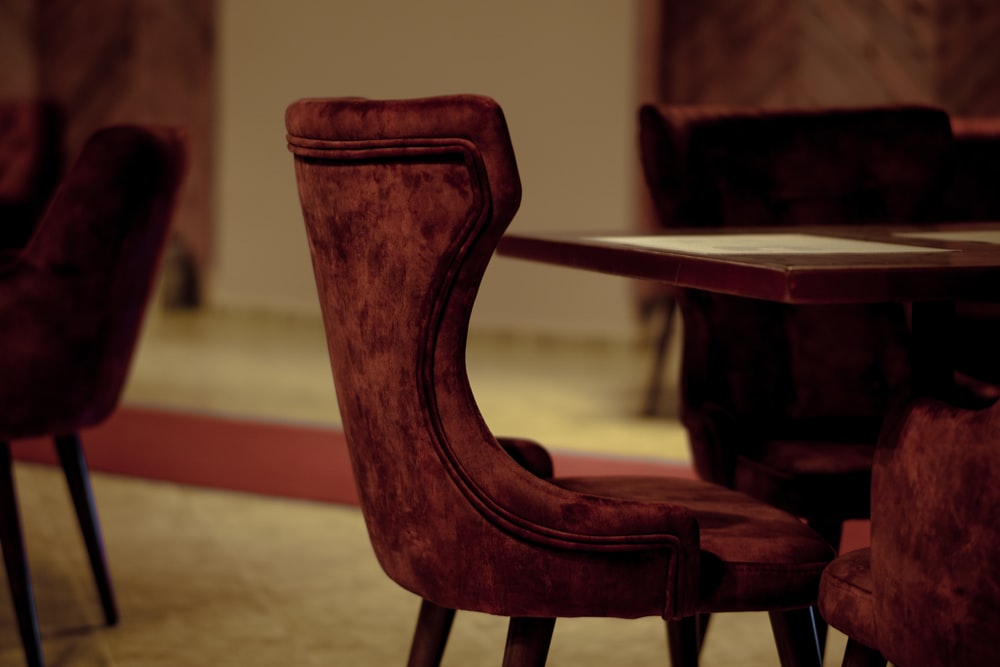 brown wooden armchair beside brown wooden table