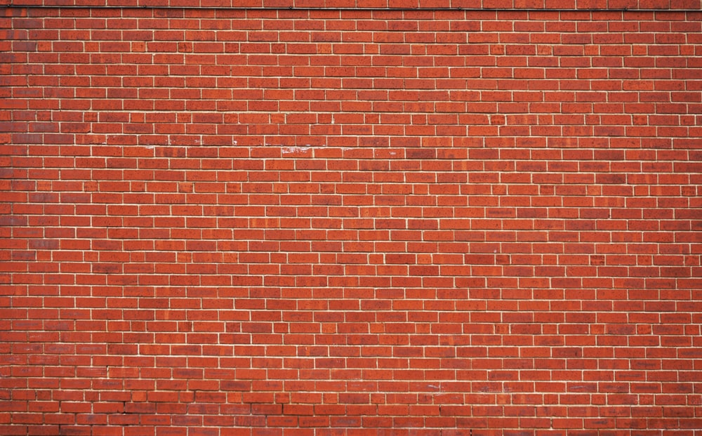 red brick wall during daytime
