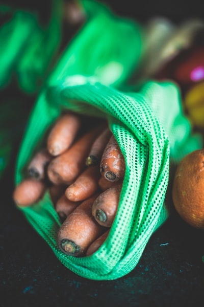 brown round fruit on green textile