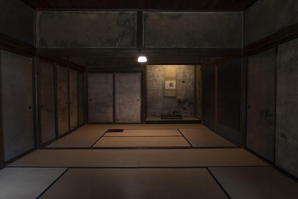 brown wooden door in room
