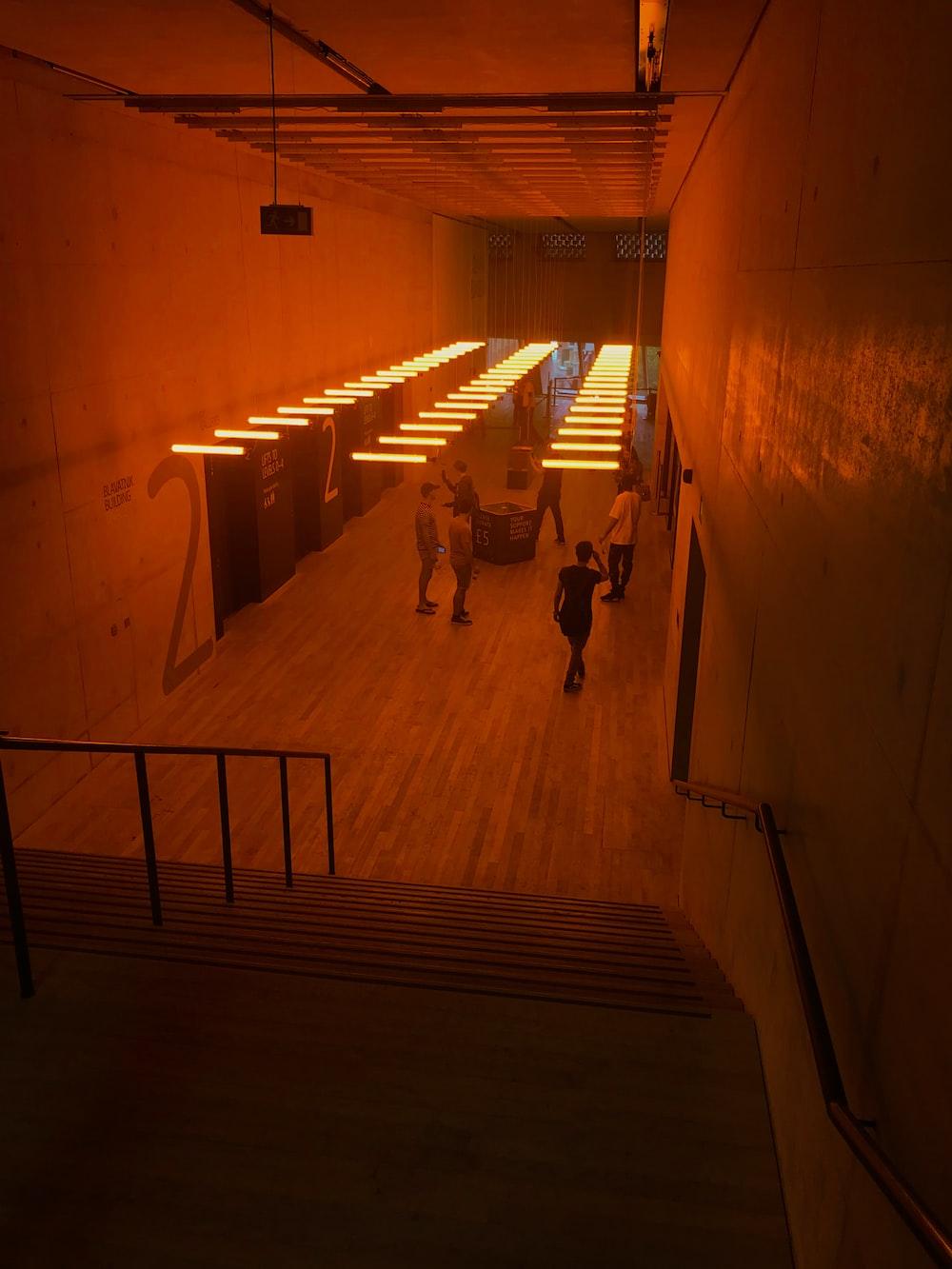 people walking on hallway during daytime
