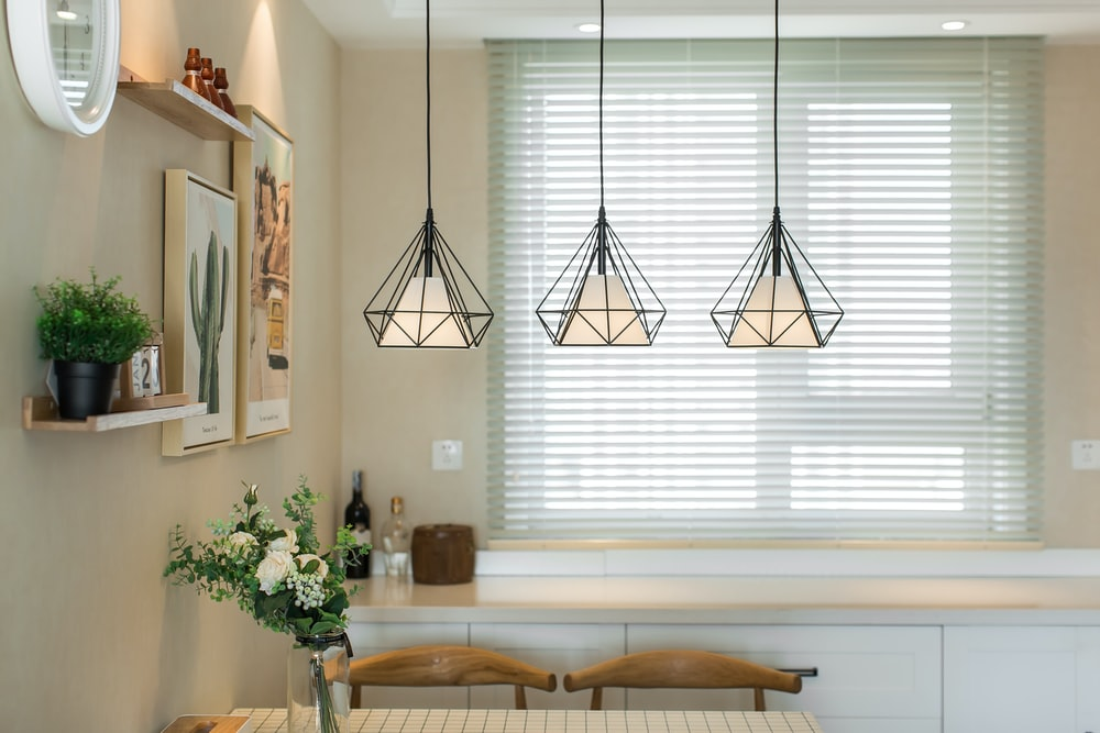 brown wooden table near white window blinds