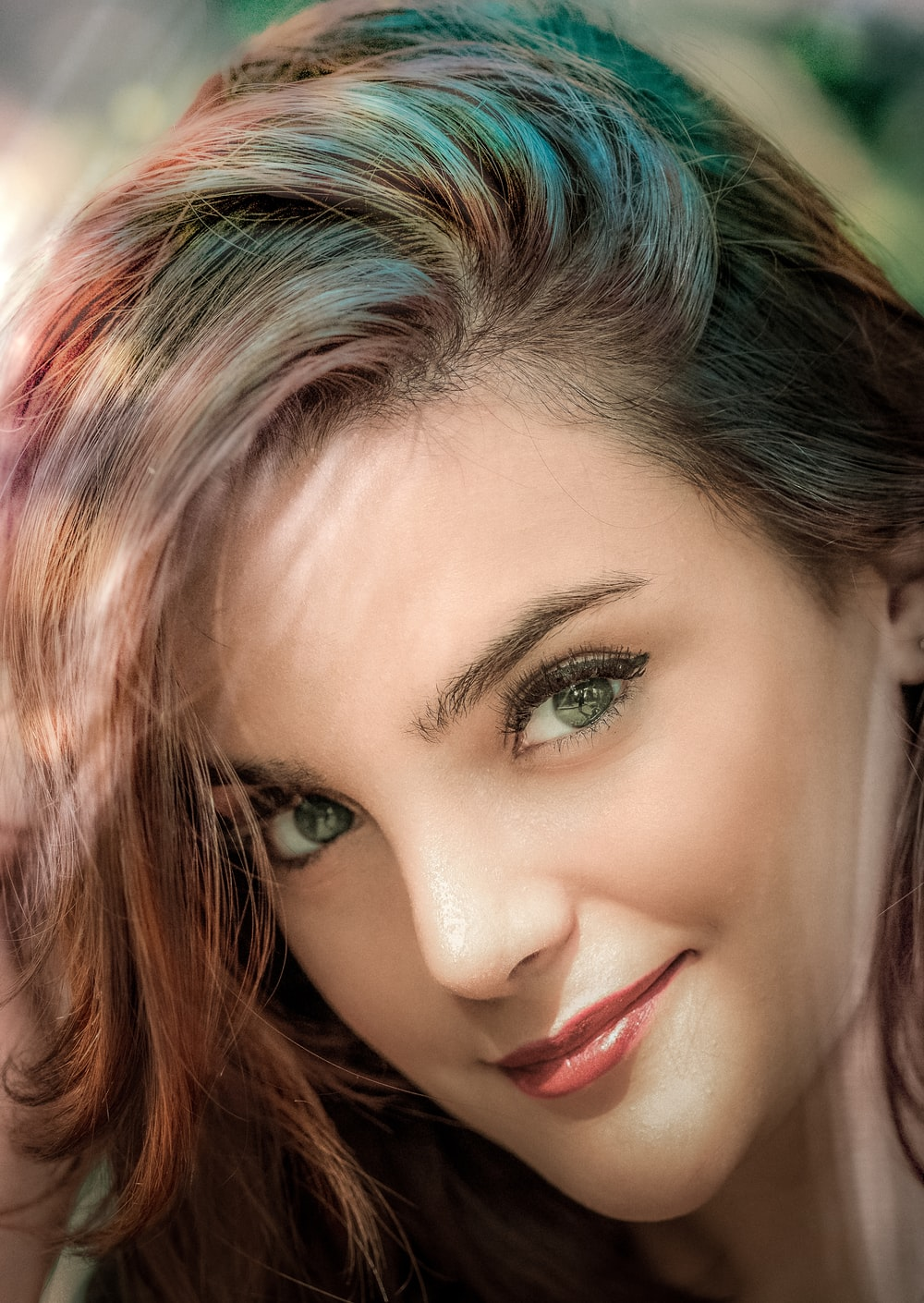 woman with blue eyes and brown hair