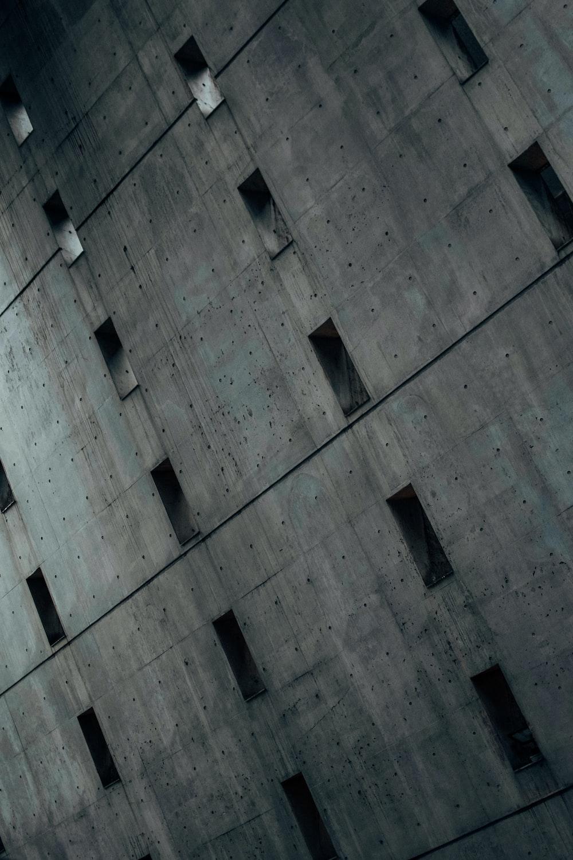 white light bulb on gray concrete building