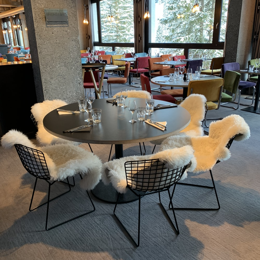 white and black round table with chairs