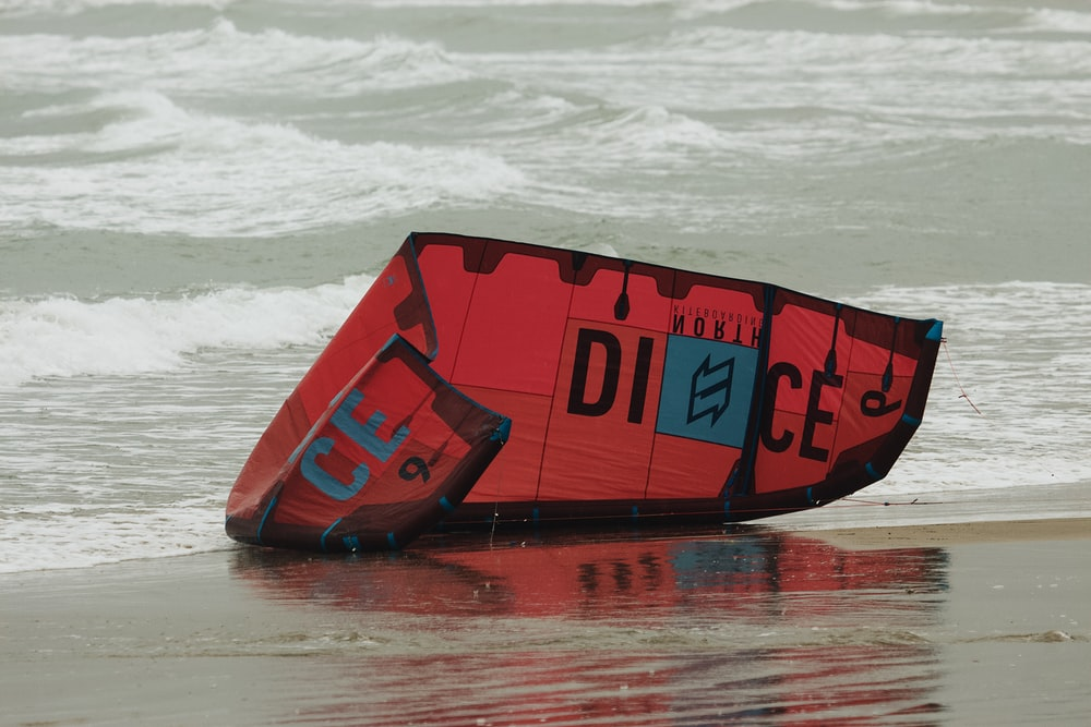 red and black surfing board on water