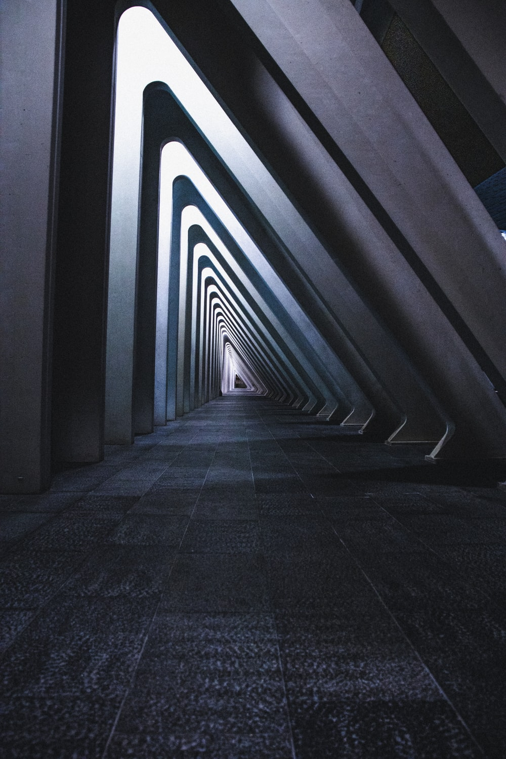gray concrete hallway with white and blue lights