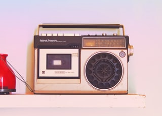 brown and black radio on white table