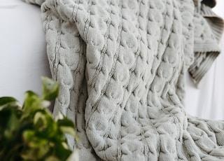 white knit textile on white textile