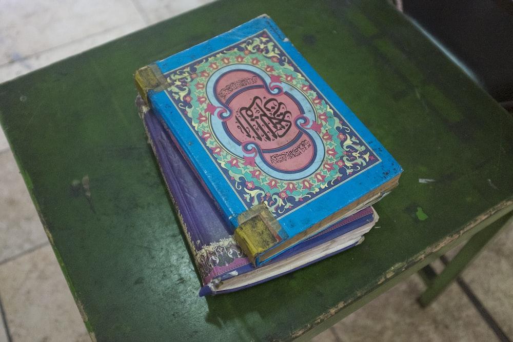 blue and green hardbound book