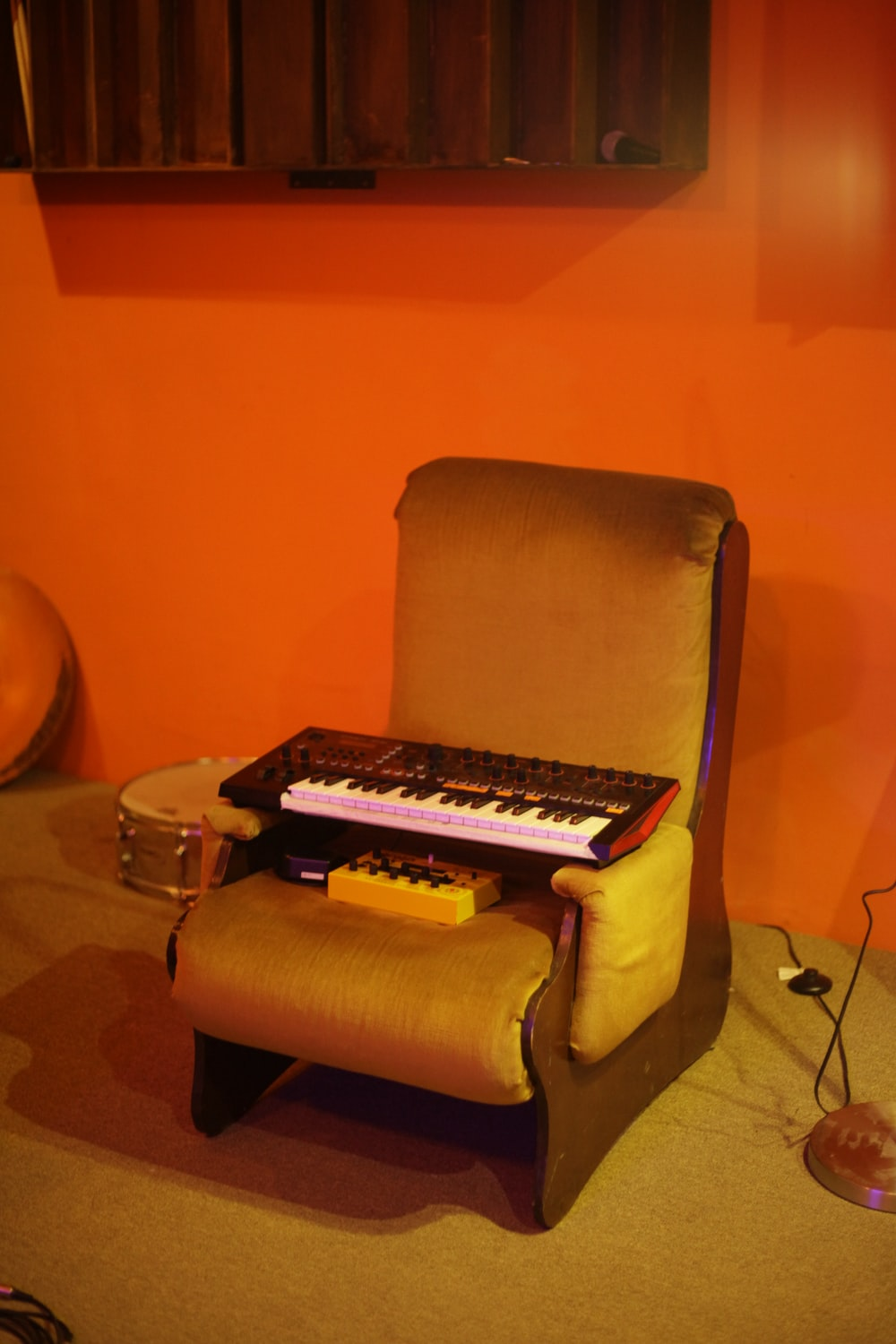 black and white piano keyboard on brown sofa chair