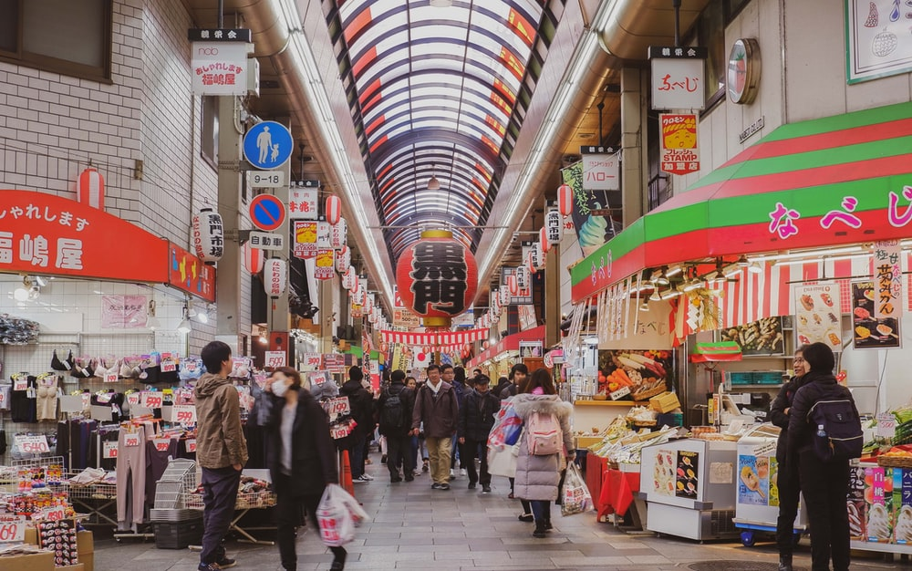 people walking on market during daytime