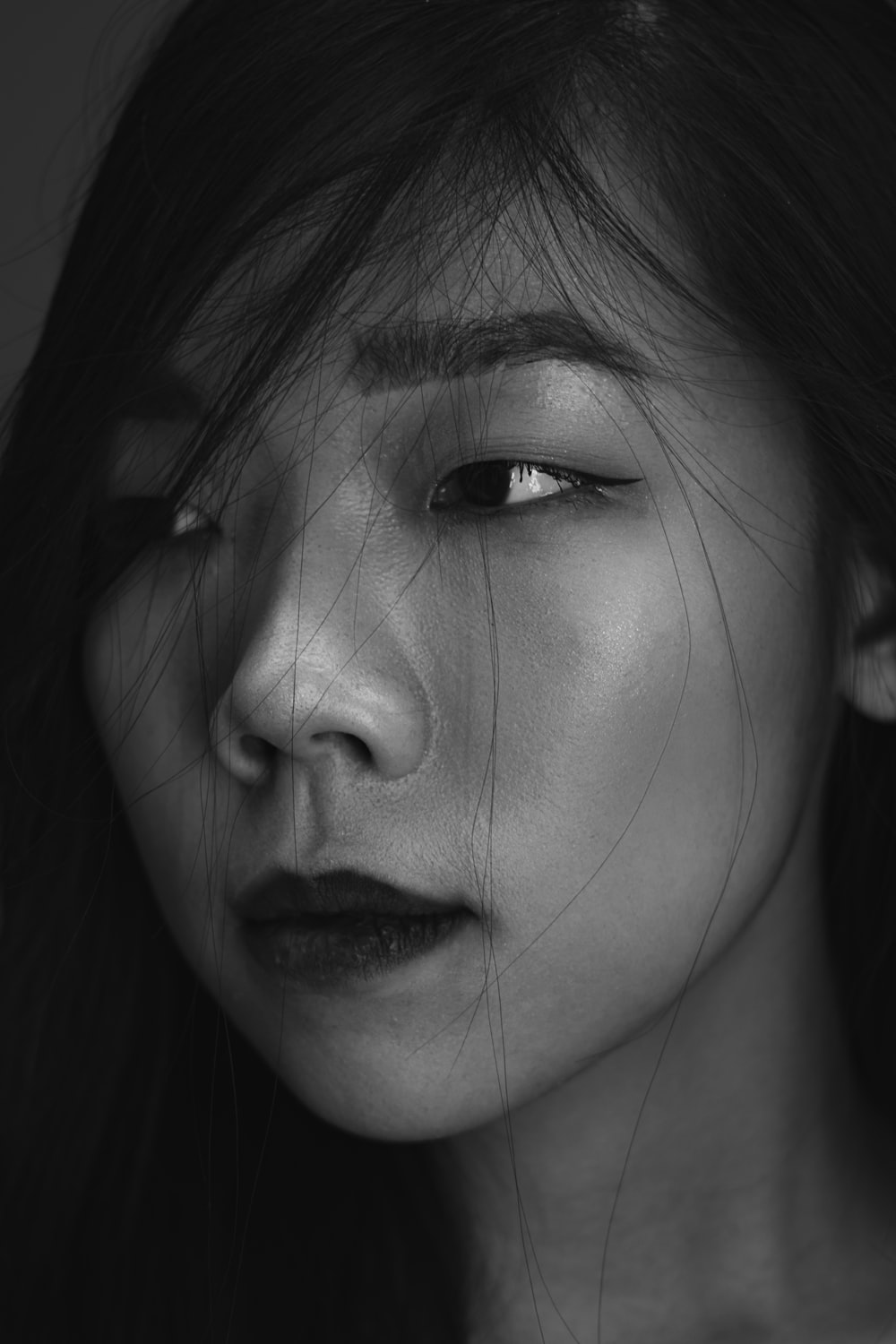 grayscale photo of girls face