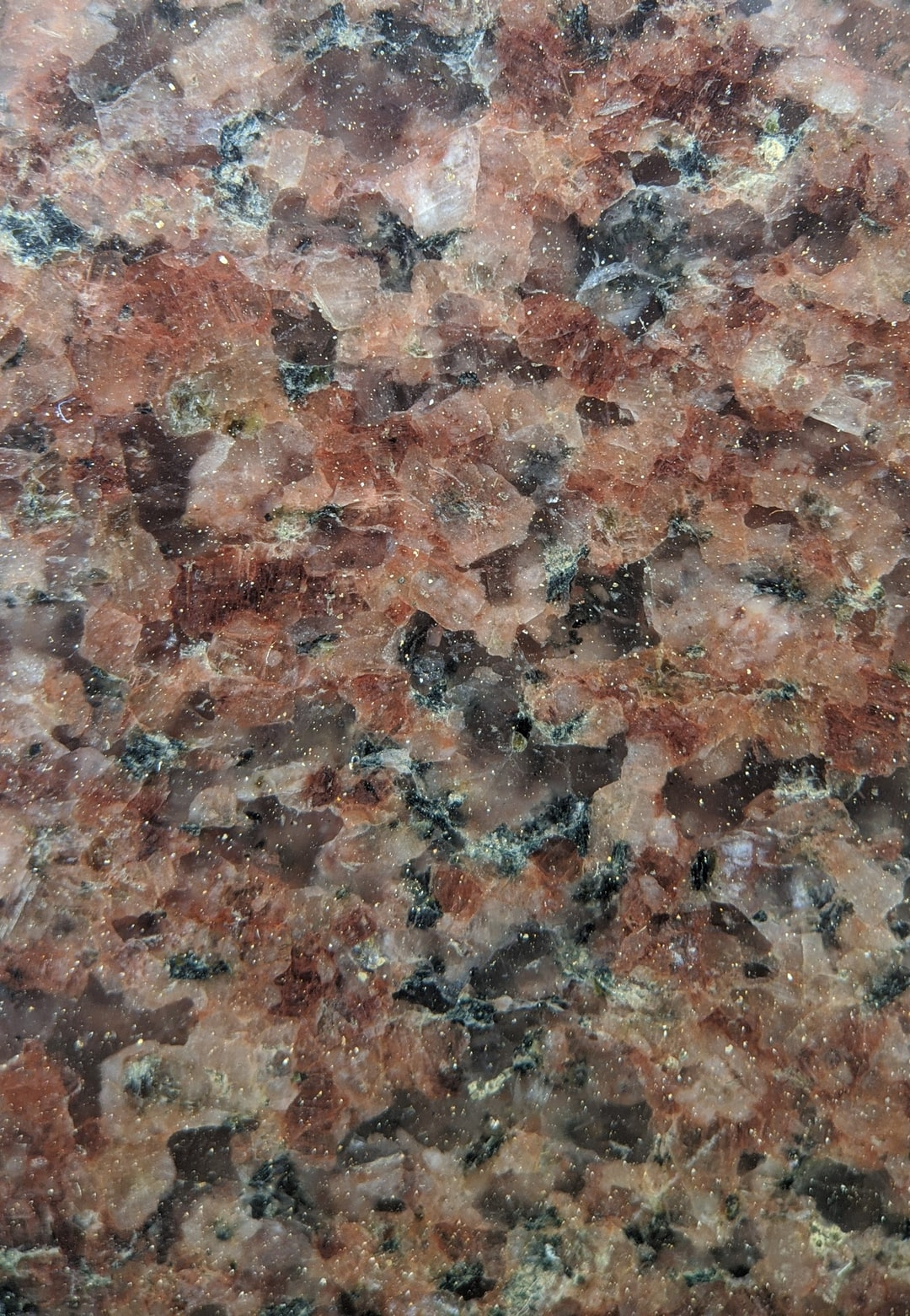 Patterns in a granite tile. Macro photography in Pixel