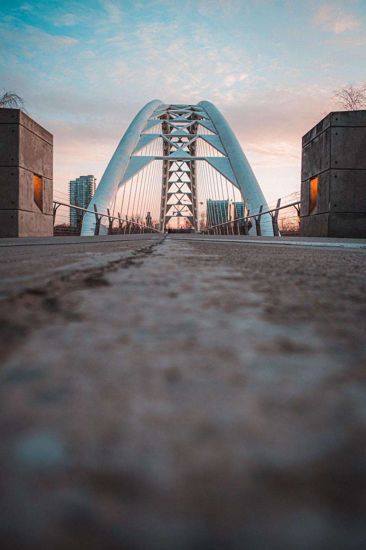 brown concrete bridge under gray sky during daytime