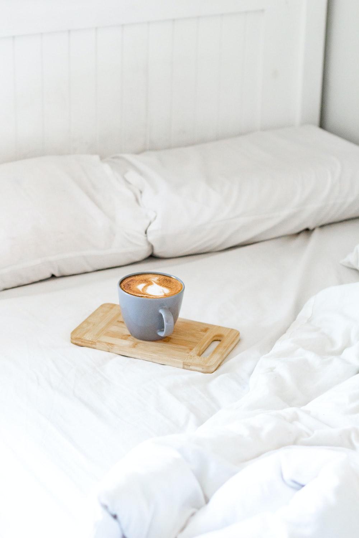 brown ceramic mug on brown wooden chopping board