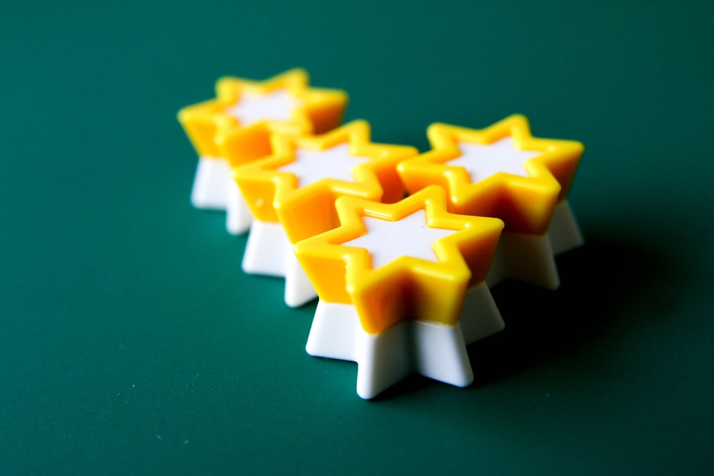 yellow and white star plastic toy