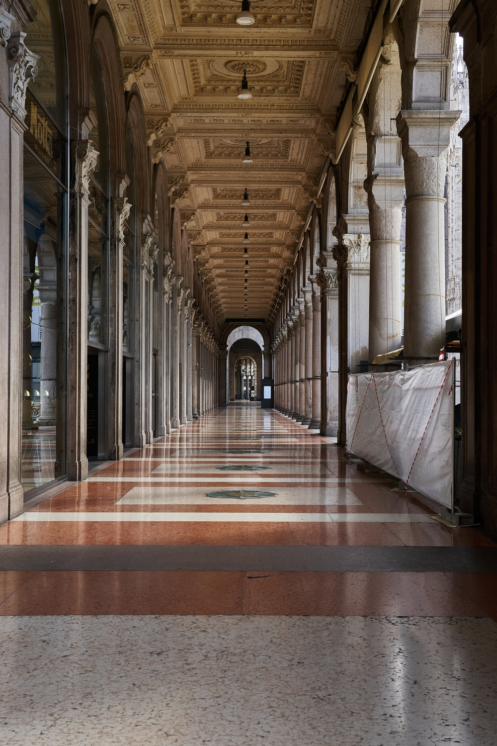 brown and white hallway with no people