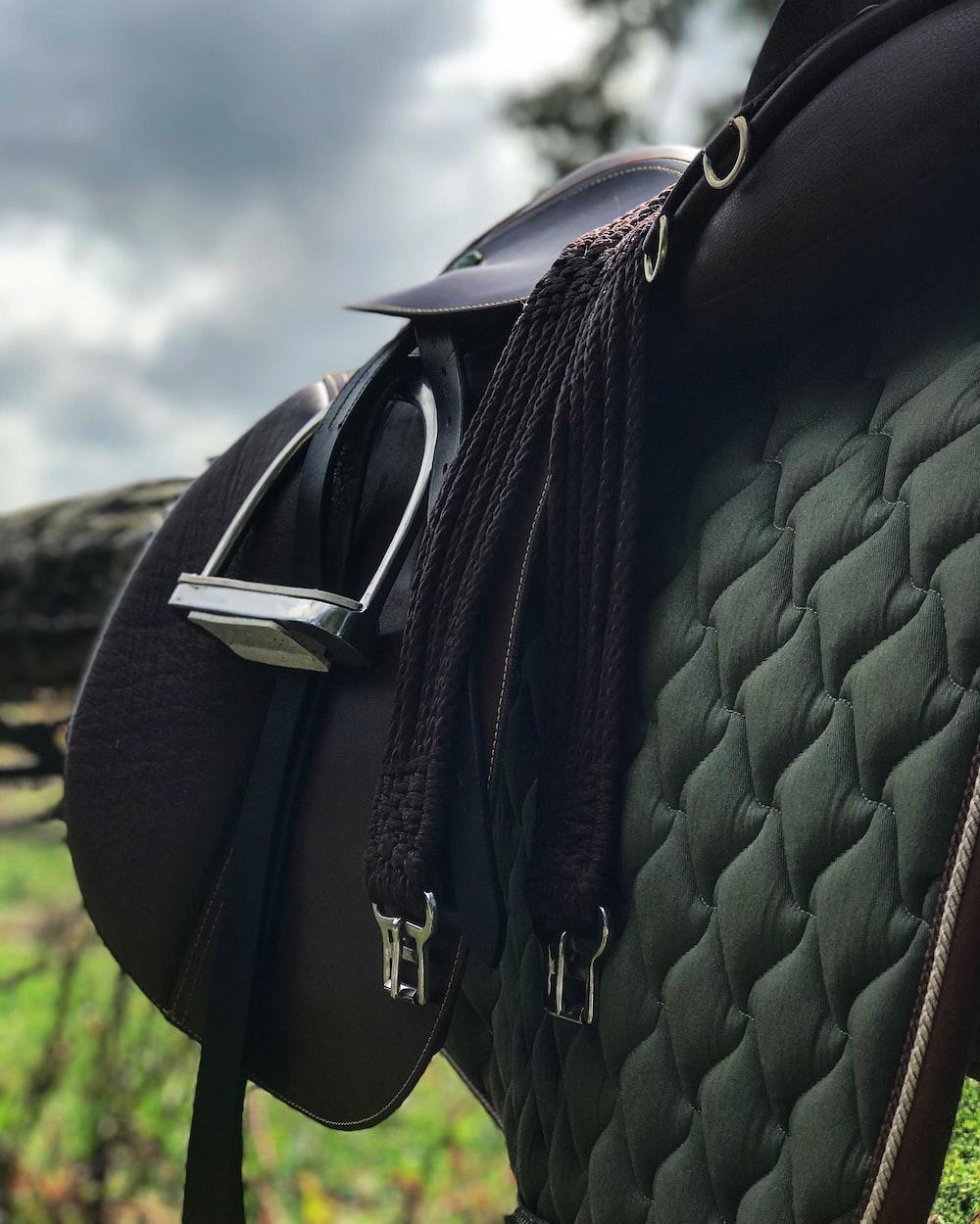black leather backpack with black leather belt