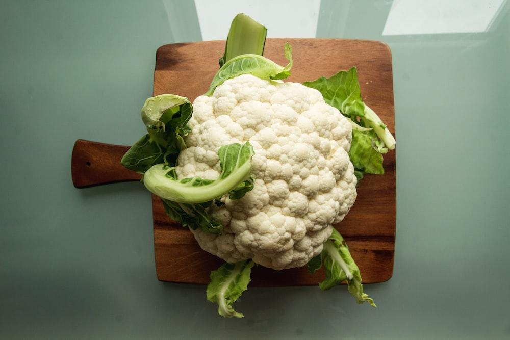 white cauliflower on brown wooden chopping board